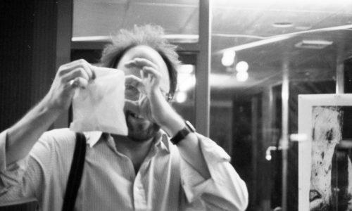 Writer, critic, poet and artist Nicholas Zurbrugg 1989 Bureau Art Space - Jane Richens Exhibition Opening Night - Photo: The Shared Camera